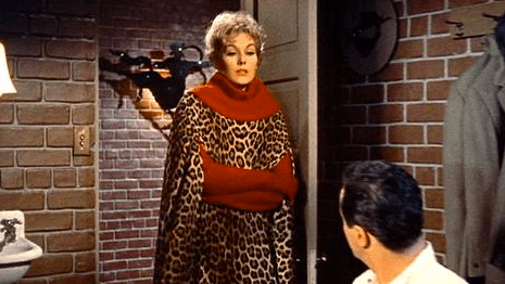 Novak as Gillian, a witch living in Greenwich Village