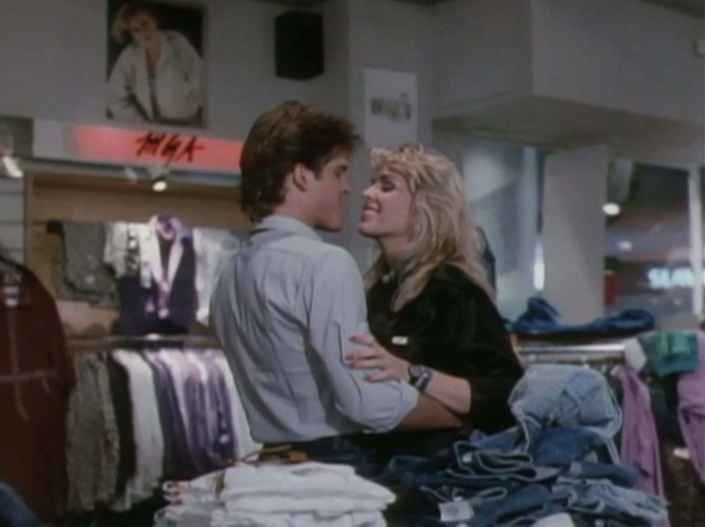 Suzzee Slater and John Terlesky in Chopping Mall