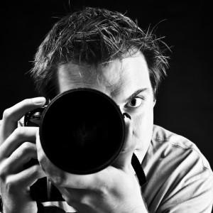 A photographer prepares to snap a photo.