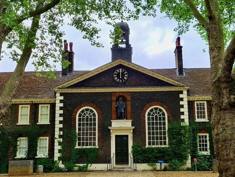 Sir Robert Geffrye statue on Tudor almshouses London
