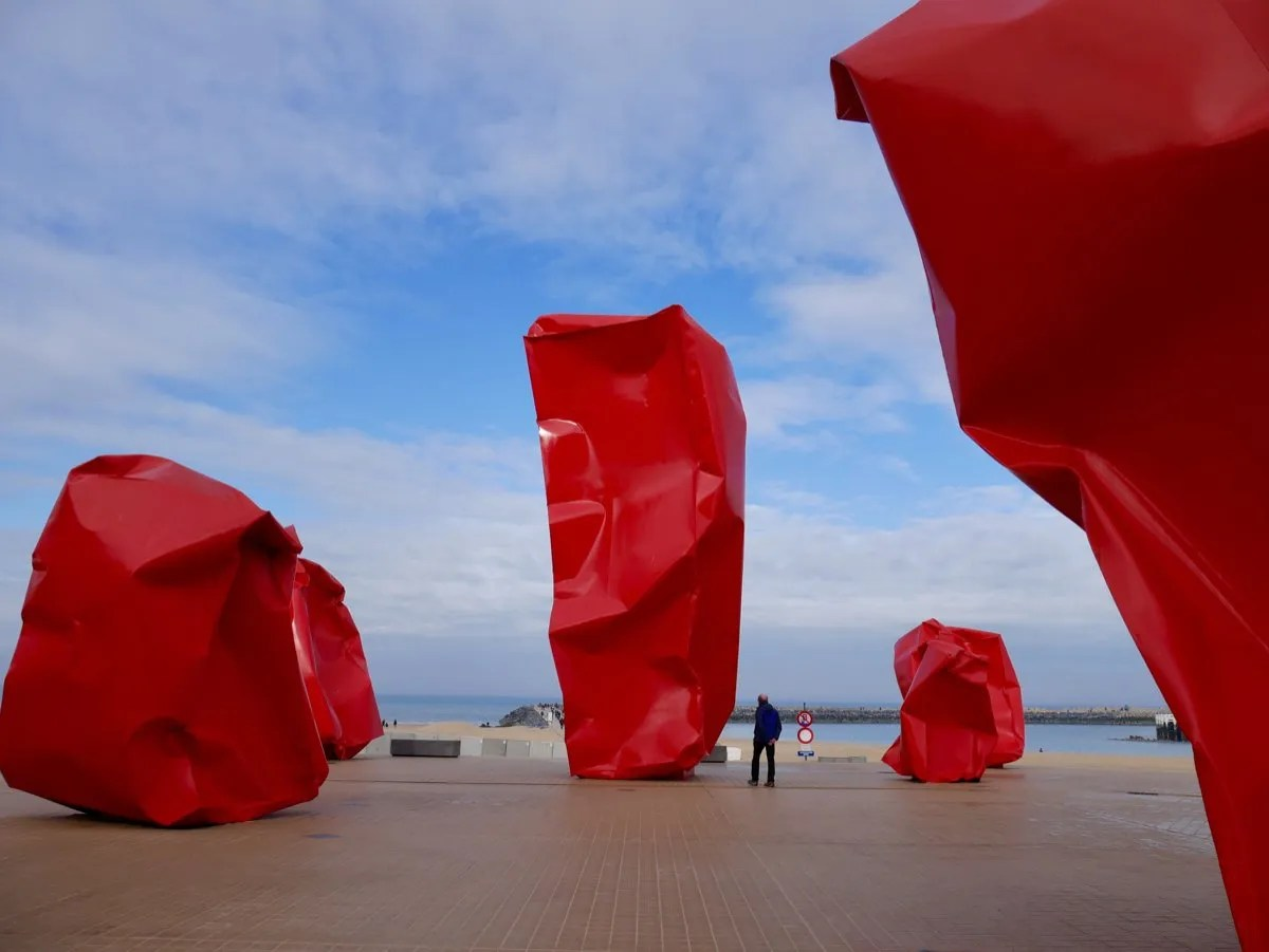 Red boulders sculpture at sea front Ostende