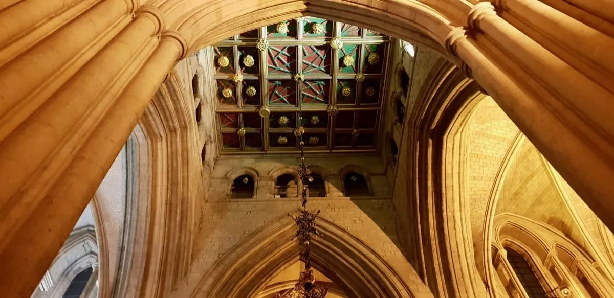 Looking up to coloured roof in medieval church