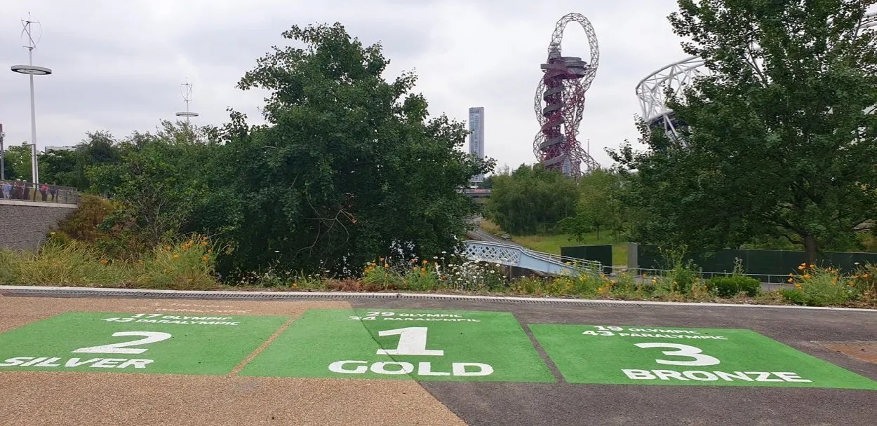 Gold Silver Bronze podium with Orbit and London Olympic Stadium in background