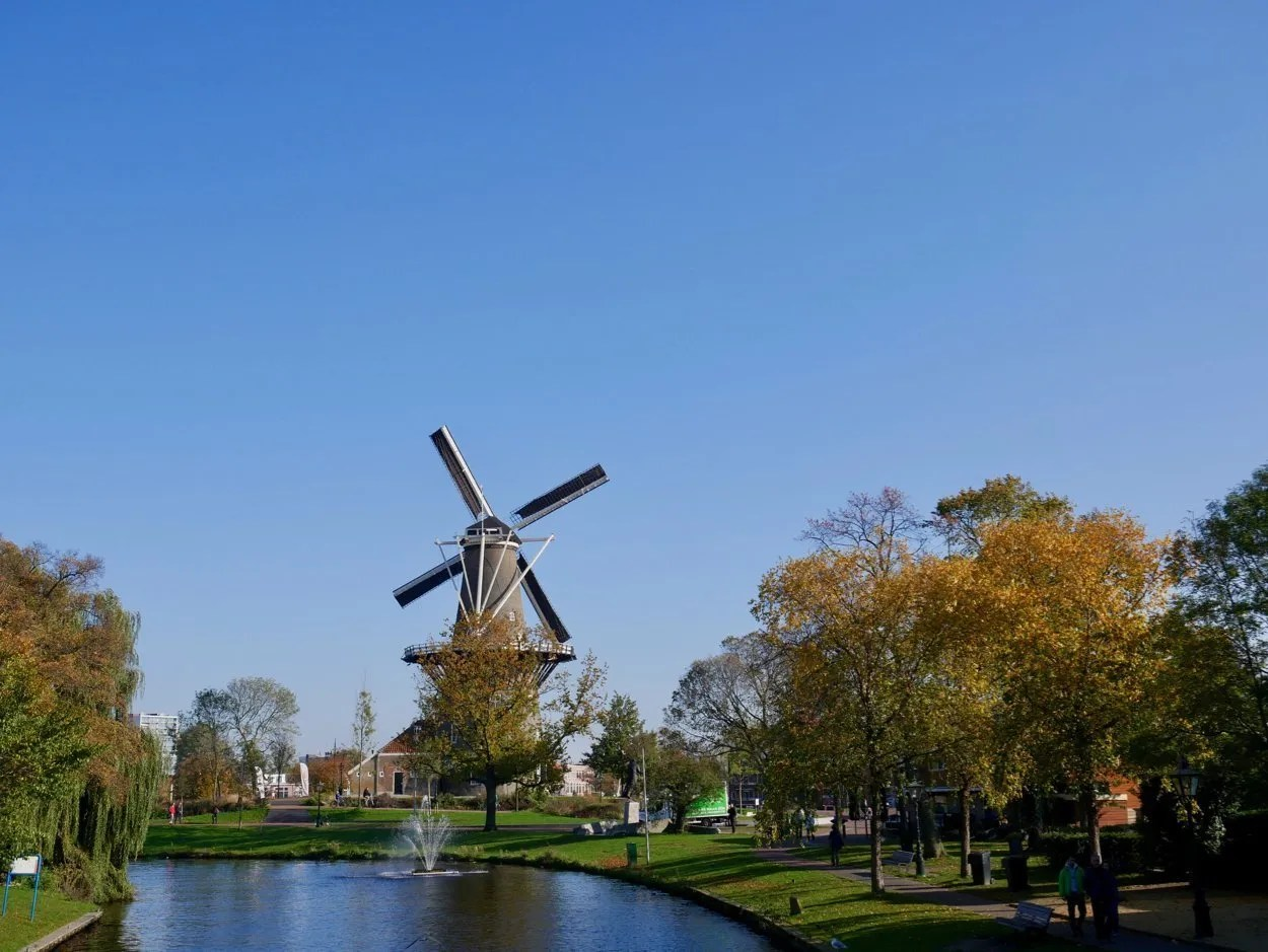 Windmill in front of water in Leiden Netherlands