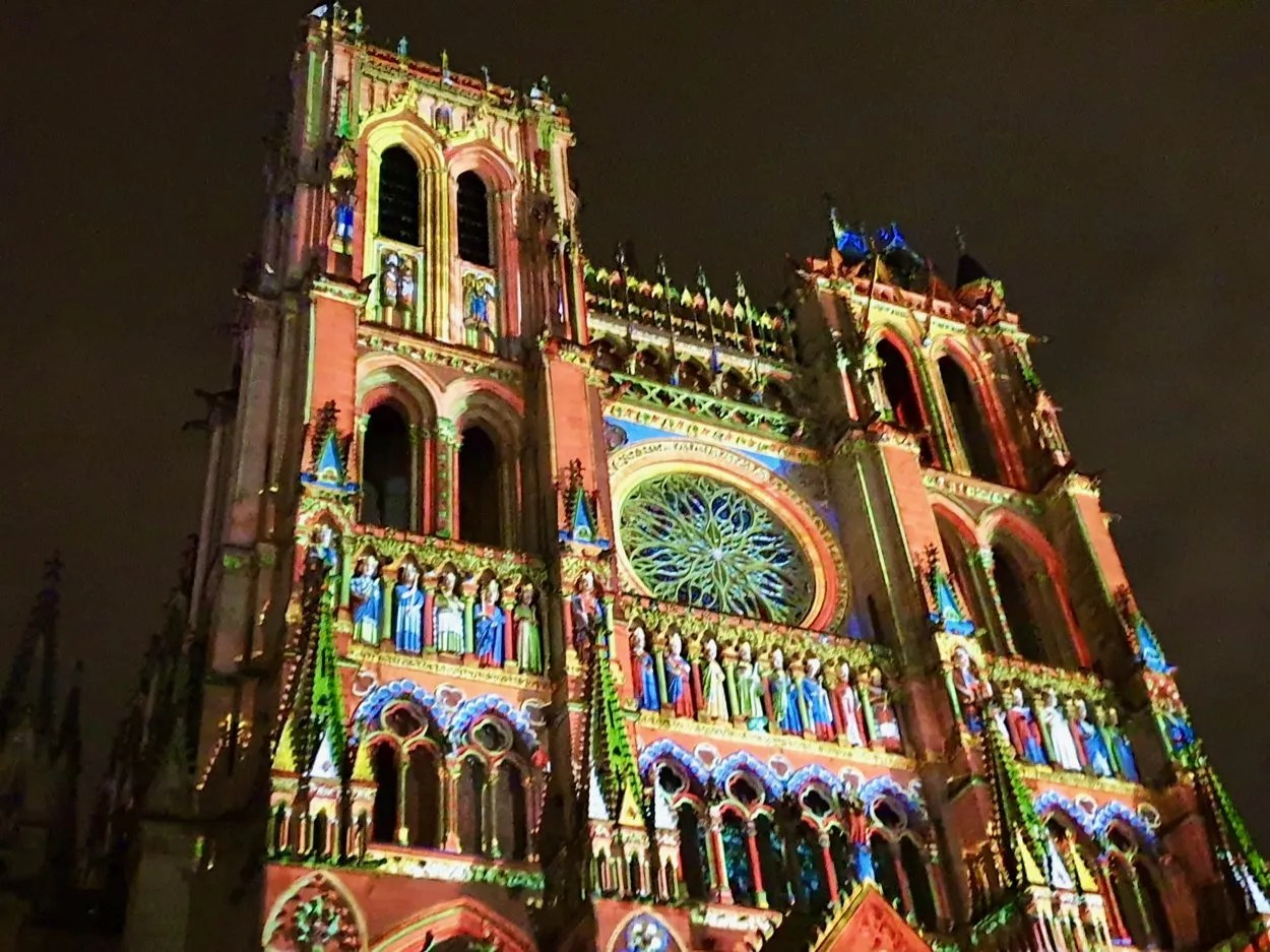 Facade of Amiens Cathedral its with coloured light during Chroma show