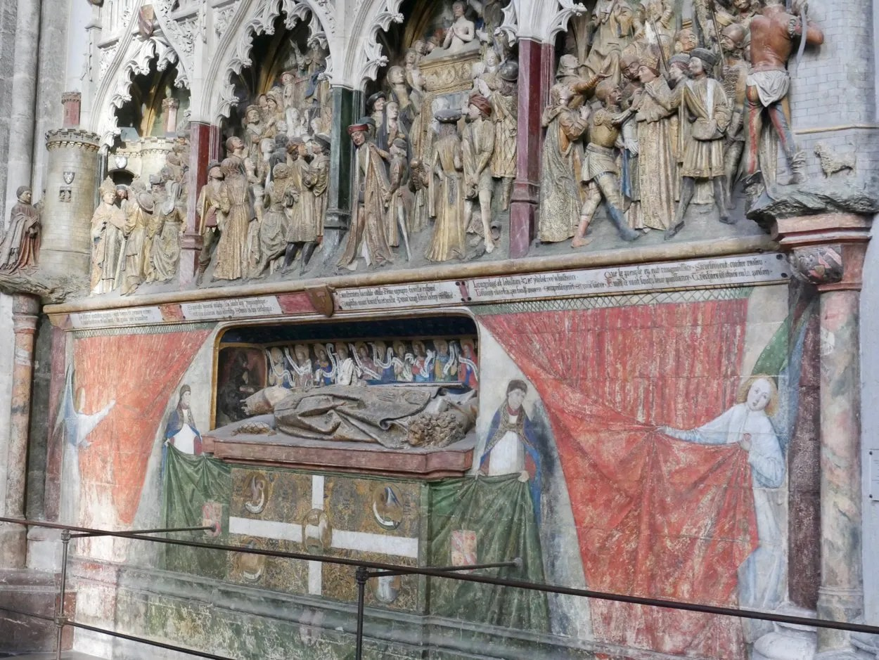 Polycrhrome figures showing life of St Firmin, wall painting showing angels pulling back curtain to reveal stone sculpture tomb of St Firmin Amiens