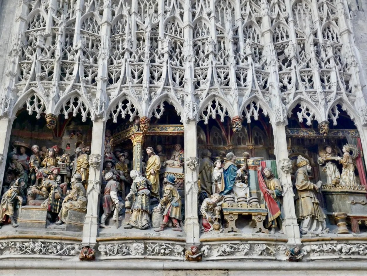 Stone filigree canopy, polychrome figures showing the life of John the Baptist Amiens Cathedral France