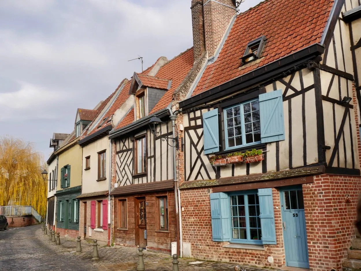 Blue shuttered, half timbered, wattle and daub houses