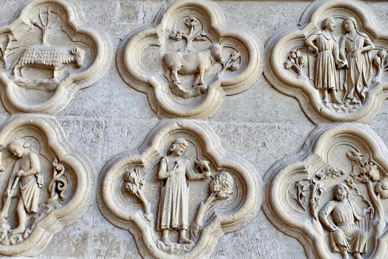 Carved stone roundels showing signs of the zodiac Amiens Cathedral