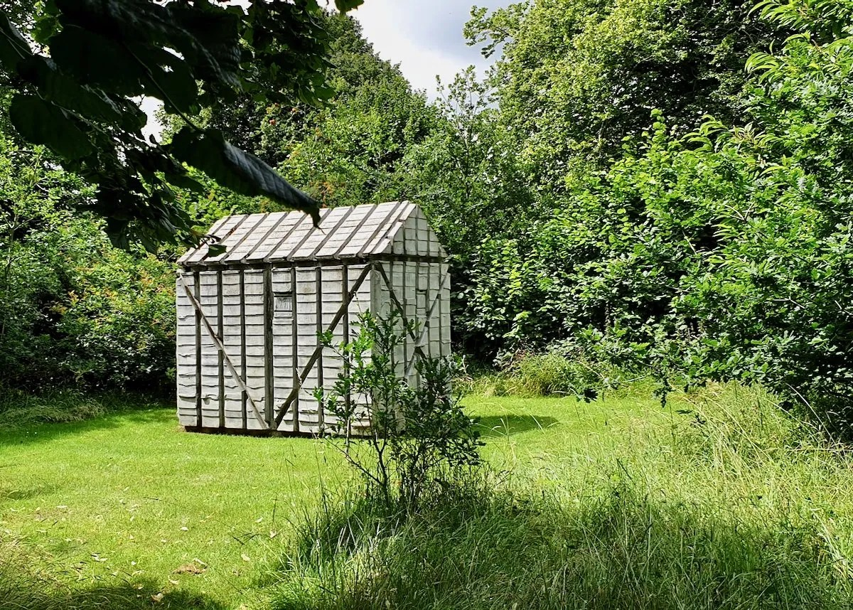 Houghton Hut by Rachel Whiteread concrete cast of garden shed in woodland glade