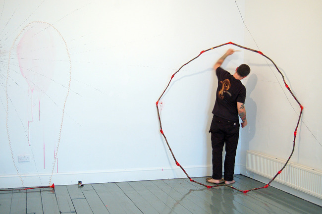 """""""Slow Burn,"""" 5 hour drawing and gong playing action at TRACE gallery, Wales 2008"""
