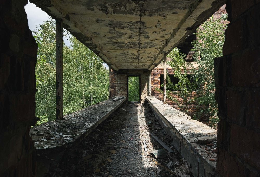 walkway between abandoned factories