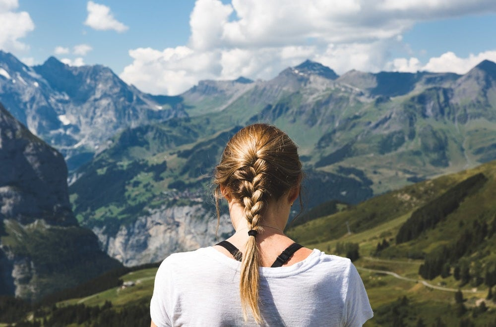 Girl overlooking the Swiss mountains
