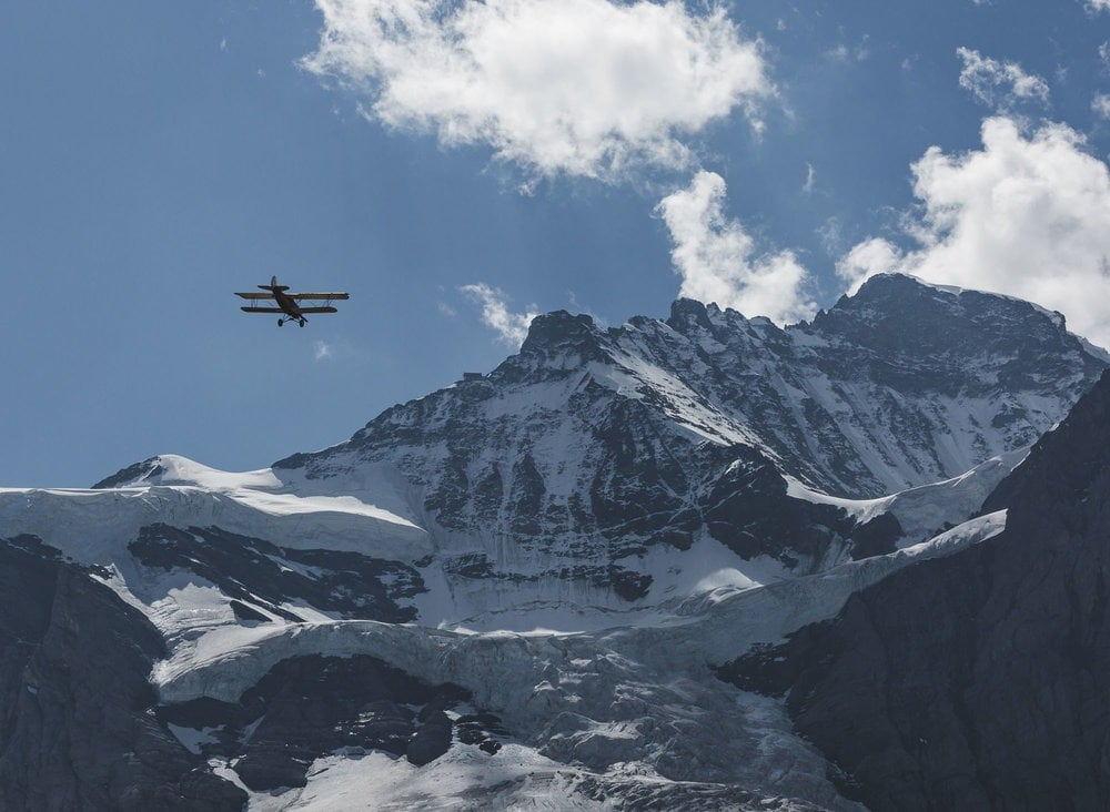 Byplane flying towards Jungfrau
