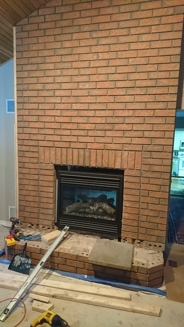 Stone Veneer Over a Brick Fireplace updates the look
