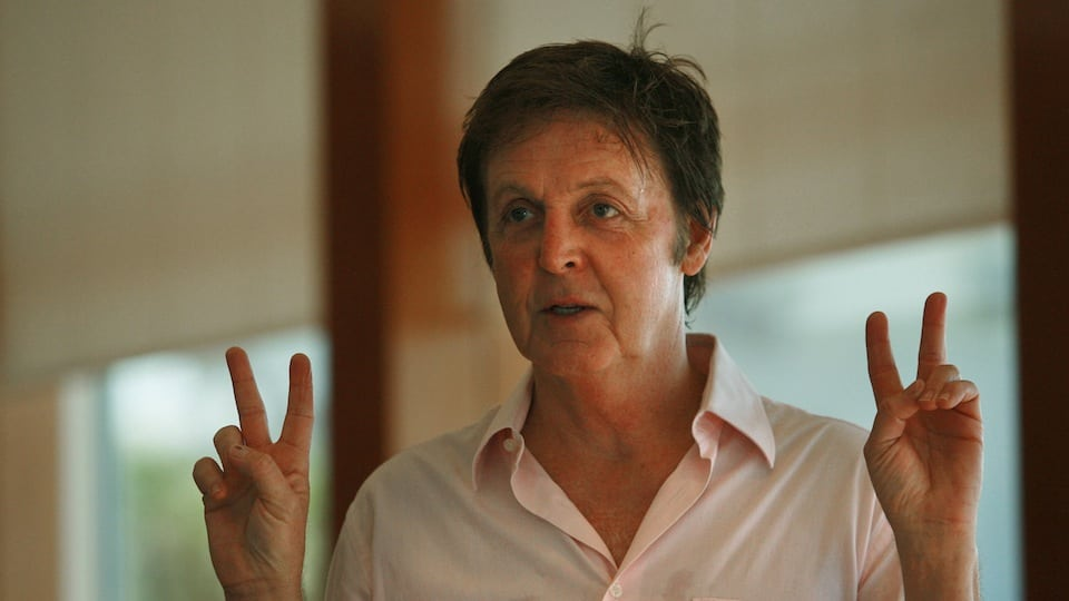 Paul McCartney Peace Signs Courtesy of Getty Images