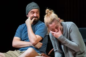 """""""Small Mouth Sounds"""" requires its ensemble cast — including Michael Glenn and Katie deBuys — to express themselves in very few words."""