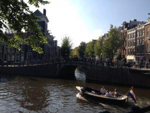 Boat on Amsterdam Canals - Photo by Jessica Lipowski