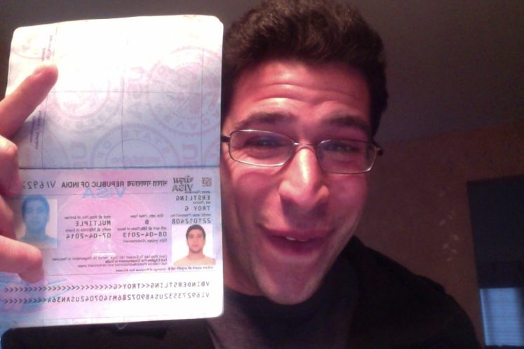 troy with a visa to work abroad