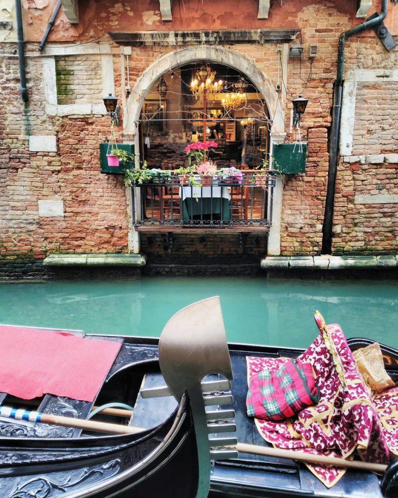 Gondole in front of a ristorante in Venice, Italy