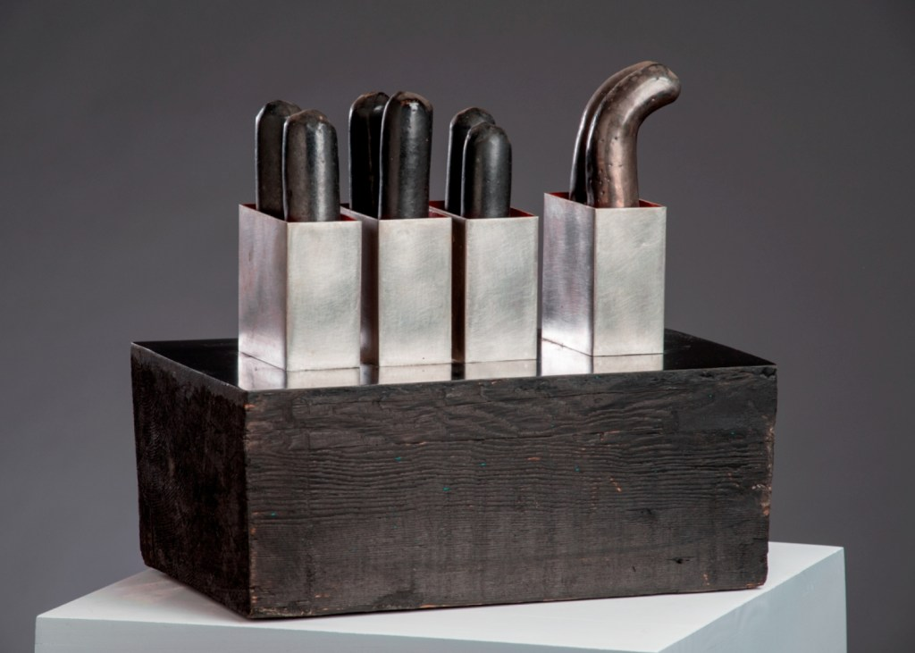 Donald Locke-Village Square, 1974, wood, vinyl. ceramic, stainless steel, 15x14.5x9 inches. Courtesy Skoto Gallery
