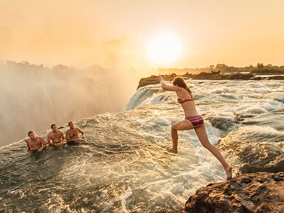 Jumping into devils pool, Victoria falls, Zambia. Top 10 Romantic Travel destination places to visit in Africa. Safest places to visit in Africa. Best cities to visit in Africa. Top tourist countries in Africa. Best destinations in Africa Places in Africa list. Top 10 tourist attractions in Africa. Most beautiful places in Africa. Holidays in African countries. #AfricanTravel #traveltoAfrica