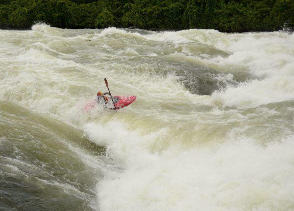 Professional Kayaker Sadat Kawawa--Kokatat Global Ambassador kayaking the White Nile River, Uganda
