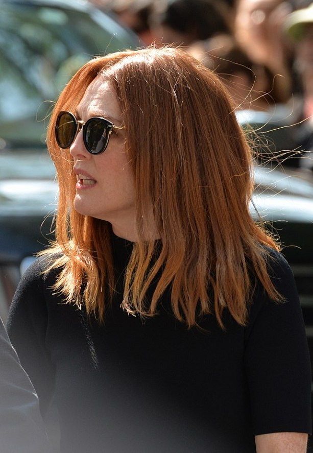 Actress Julianne Moore wearing a black shirt, with sunglasses on.