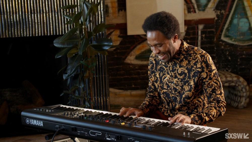 Man, Dayramir Gonzalez playing an electric keyboard.
