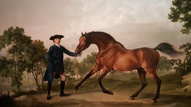 George Stubbs, Balnk, de bruine hengst van de Duke of Ancaster, begeleid door Old Parna, c 1761, doek 11,4 x 125,8 cm.The trustees of the Grimsthorpe Drummond Castle Trust Limited