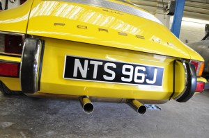 Offending cream-crackered twin pipe silencer in better times