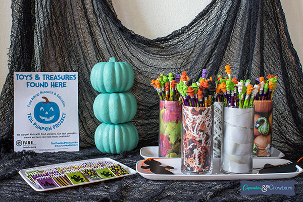 Teal pumpkin and flyer halloween display table