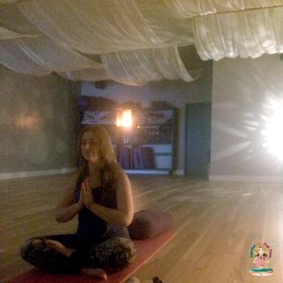 Angela Tague doing the lotus yoga pose. Cupcakes and Yoga Pants blog