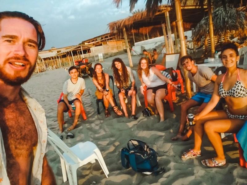 travellers on beach of mancora peru