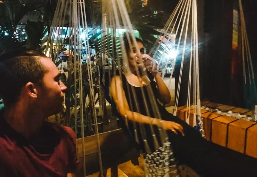 2 backpackers in a bar in Montañita Ecuador nightlife