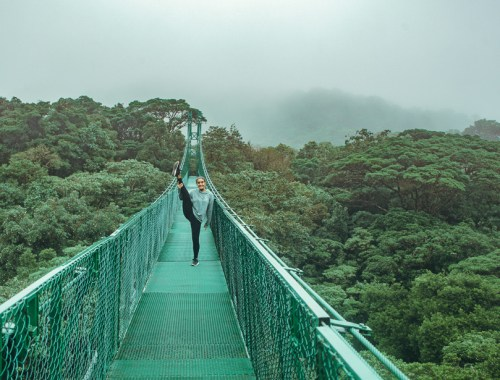 Backpacker girl on bridge in Monteverde: 11 things to know about costa rica pura vida