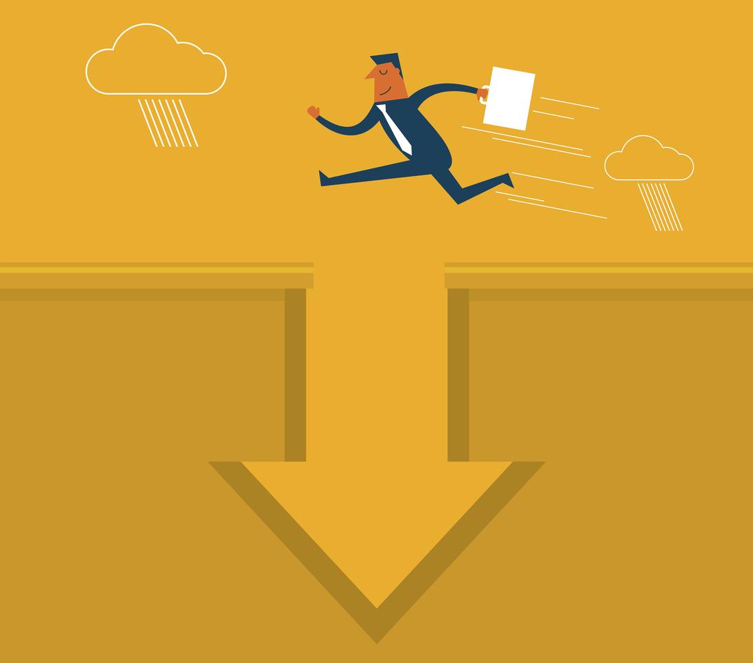Businessman jumping over pitfall