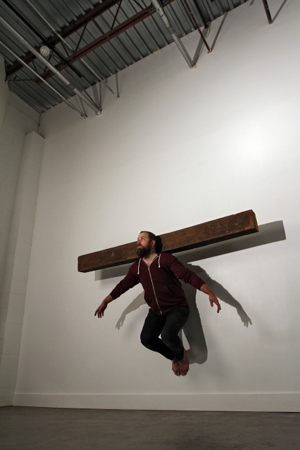"""Ascension"" 125lb oak beam (Documentation of a live performance)"