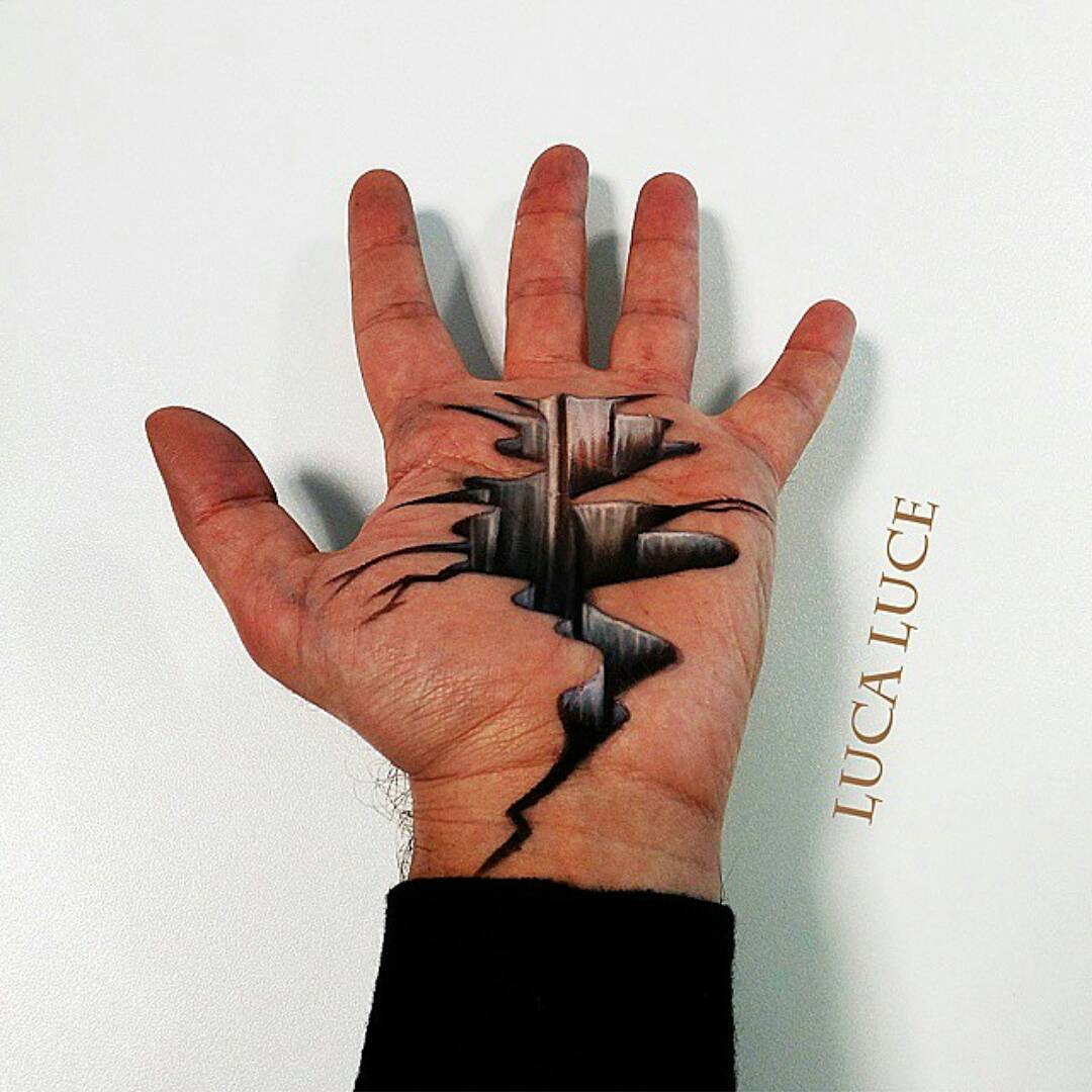 an italian make-up artist creates mind bending 3d art on the palm of his hand