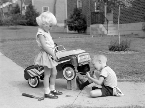 h-armstrong-roberts-children-on-suburban-sidewalk-boy-playing-as-mechanic-oiling-toy-pedal-car
