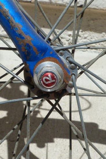 """Raleigh added several cool touches, like the """"R"""" nut on the front wheel. These are hard to find now. eBay is pretty amazing."""