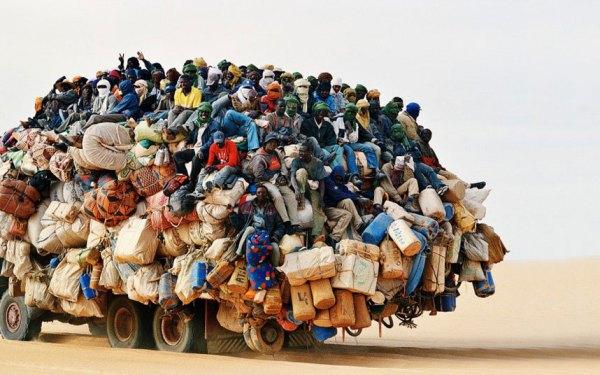 africa overloaded passengers --truck_3023038k