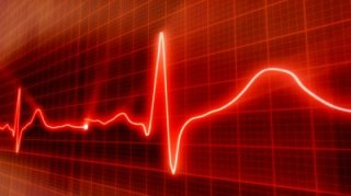 stock-footage-seamless-loop-red-background-ekg-electrocardiogram-pulse-real-waveform