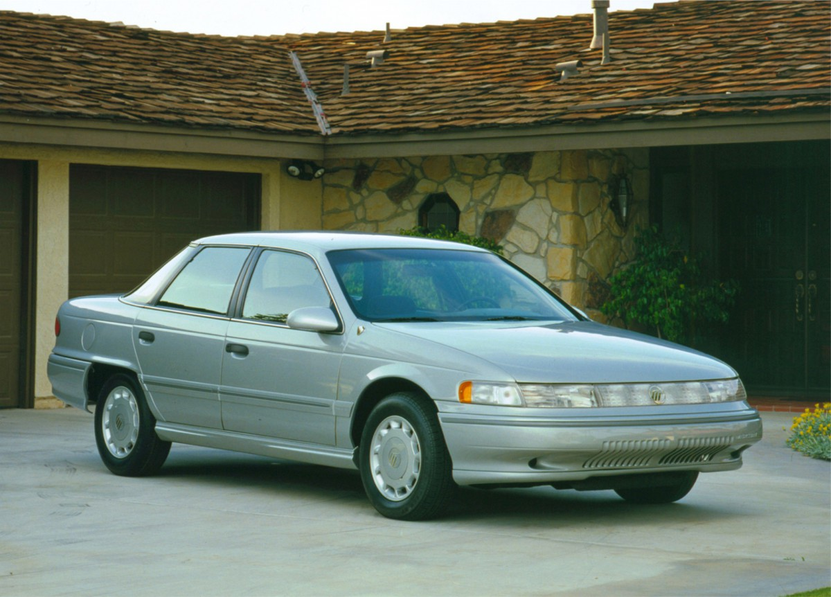 """Retaining its front """"lightbar"""", wraparound rear windshield, and skirted  wheels, the Mercury Sable continued on slightly more highly-styled path  than its ..."""
