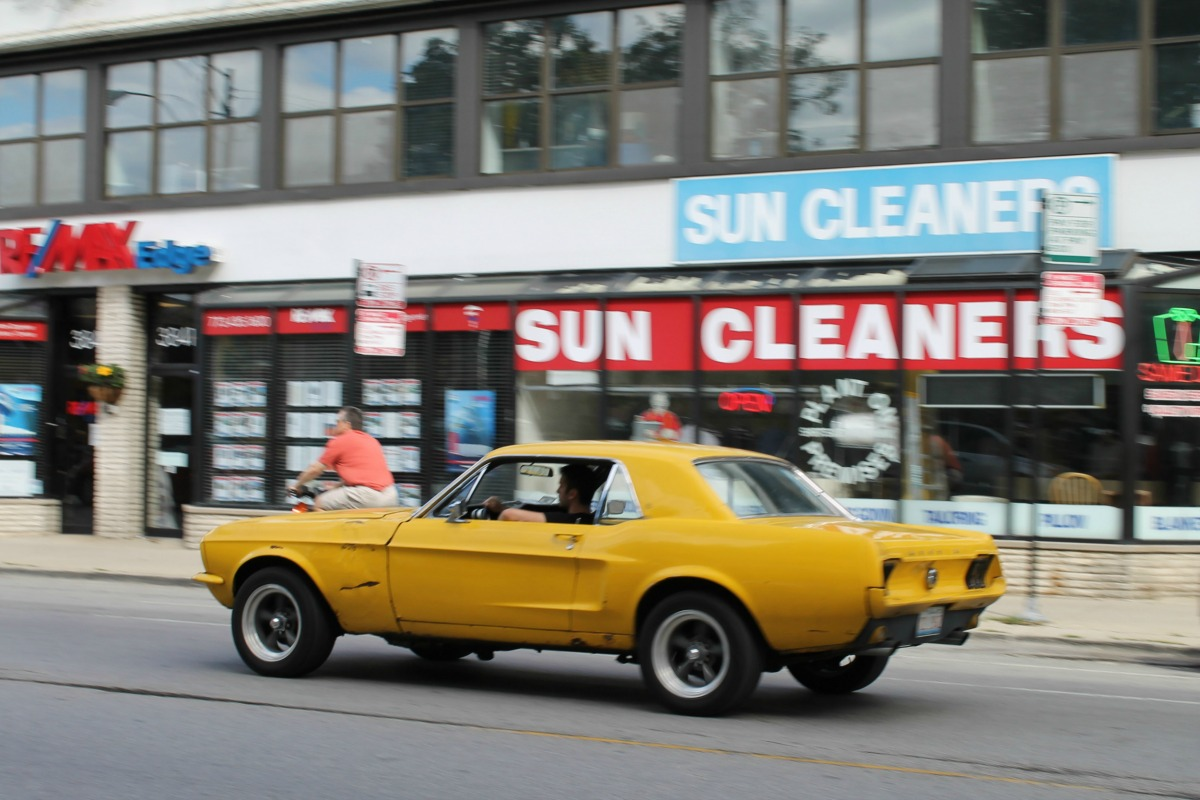 In motion classic 1967 ford mustang notchback spicy mustard