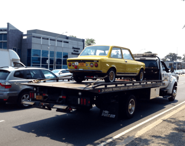 Fiat 128 on tow truck