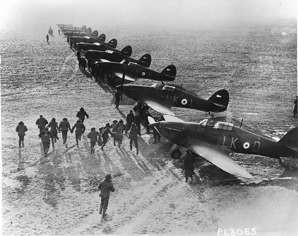 "Scramble"" is the command which sends these Royal Canadian Air Force pilots in Britain racing to their Hurricanes to battle the Nazis in the sky."