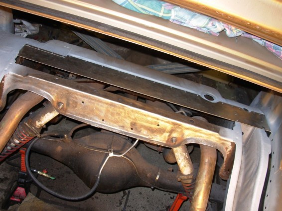 Replacing rotted out section where trunk pan overlaps floorpan.