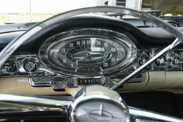 1957 Oldsmobile Instrument Panel – Two instruments, lots of lights.
