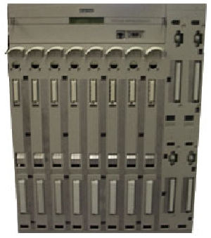 A DEChub 900 frame with room for 4 power supplies (right) and 8 networking modules